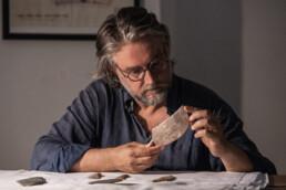 Giulio Lucarini analysing Predynastic lithics at the Museo dell'Opera del Duomo, Bracciano (Rome). Photo: Sabrina Martin